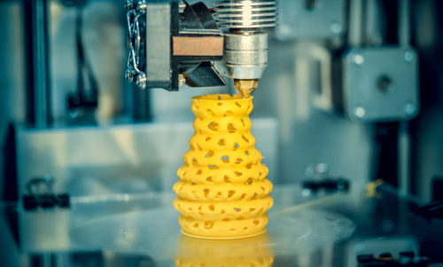3d printer printing objects yellow form closeup